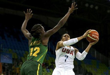 The US' Maya Moore drives on Senegal's Mama Marie Sy during their opening Olympic game/Photo: Shannon Stapleton/Reuters
