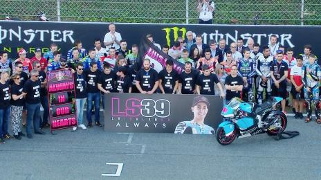 Many took to the track ahead of the races to perform a minute's silence in Salom's honour - www.motogp.com