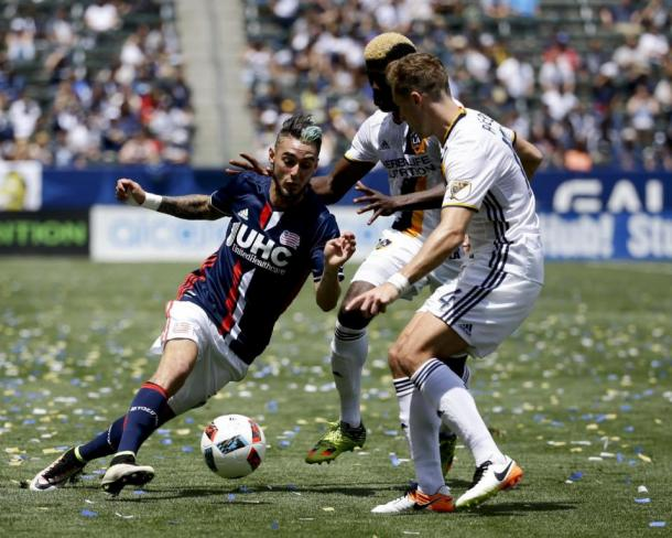 Revolution's Diego Fagundez (Left) being marked closely by LA's Gyasi Zardes (Back) and Robbie Rogers (Center) on Sunday at the StubHub Center. Photo provided by Chris Carlson-AP Photo.