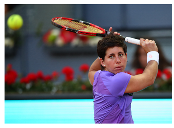 Carla Suarez Navarro of Spain in action against Samantha Stosur of Australia in their third round match during day five of the Mutua Madrid Open tennis tournament at the Caja Magica on May 04, 2016 in Madrid. (Clive Brunskill/Getty)