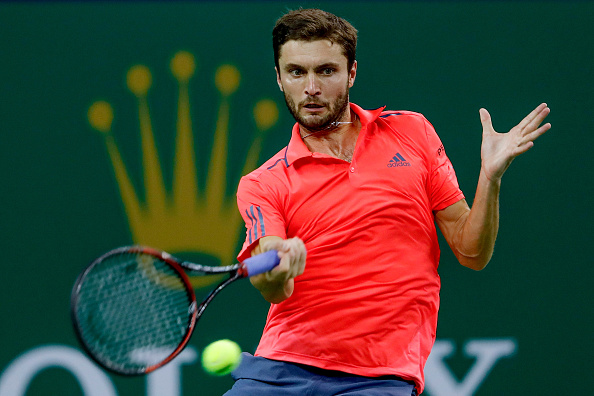 Gilles Simon hits a return (Photo: Lintao Zhang/Getty Images)