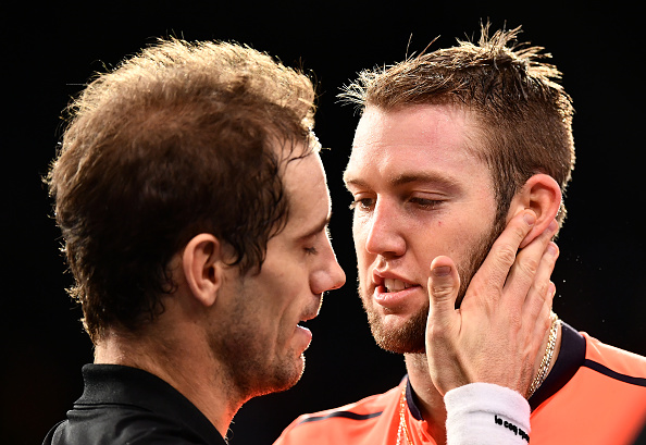 Jack Sock congratulasted by Richard Gasquet (Photo: Dan Mullan/Getty Images)
