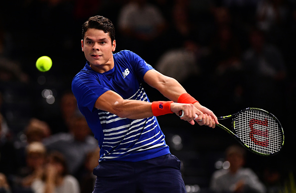 Milos Raonic plays a backhand to Jo-Wilfried Tsonga (Photo: Dan Mullan/Getty Images)