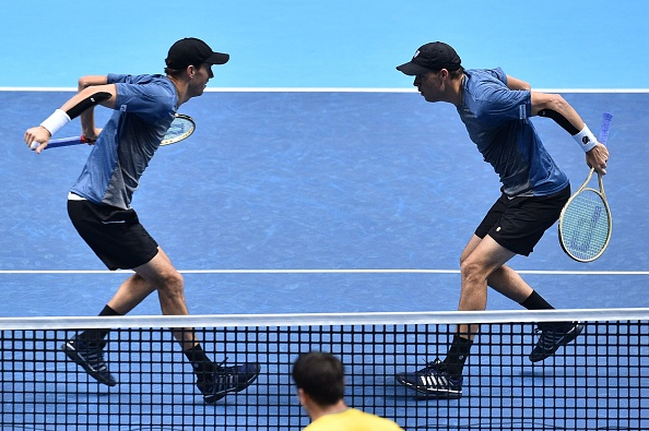 Bryan Brothers celebrate with traditional chest bump following victory (Photo: Glyn Kirk/Getty Images)