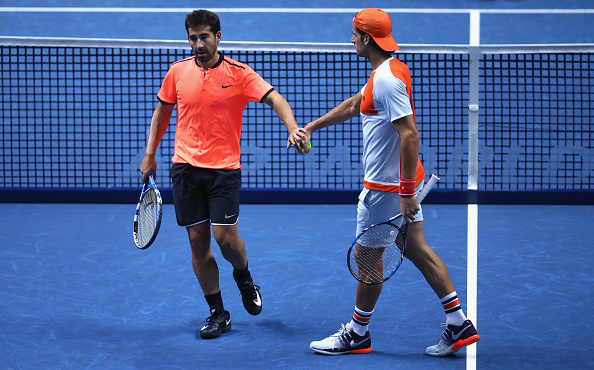 Feliciano Lopez and Marc Lopez come together after winning a point (Photo: Alex Pantling/Getty Images)
