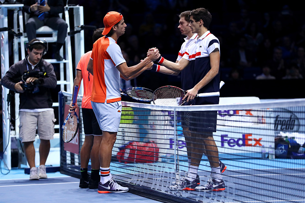 Feliciano Lopez and Marc Lopez shake hands with Pierre-Hugues Herbert and Nicolas Mahut (Photo: Julian Finney/Getty Images)