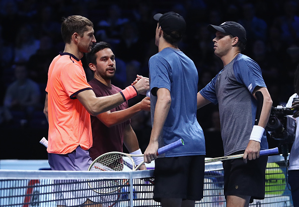 Bob and Mike Bryan being congratulated by Treat Huey and Max Mirnyi (Photo: Julian Finney/Getty Images)