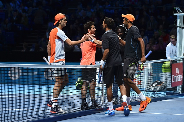 Raven Klaasen and Rajeev Ram shake hands with Feliciano Lopez and Marc Lopez (Photo: Glyn Kirk/Getty Images)