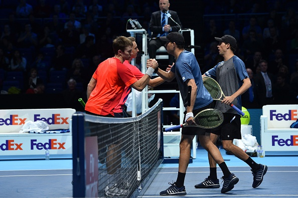 Henri Kontinen and John Peers are congratulated at the net by Bob Bryan and Mike Bryan (Photo: Glyn Kirk/Getty Images)