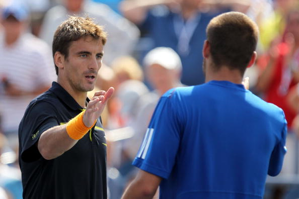 Tommy Robredo and Mikhail Youzhny, who are to make their returns shake hands after their 2010 US Open match (Photo: Al Bello/Getty Images)