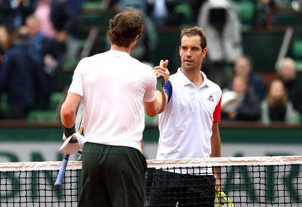 Richard Gasquet shaking hands with Andy Murray after making the quarterfinals of Roland Garros (Photo: Julian Finney/Getty Images)