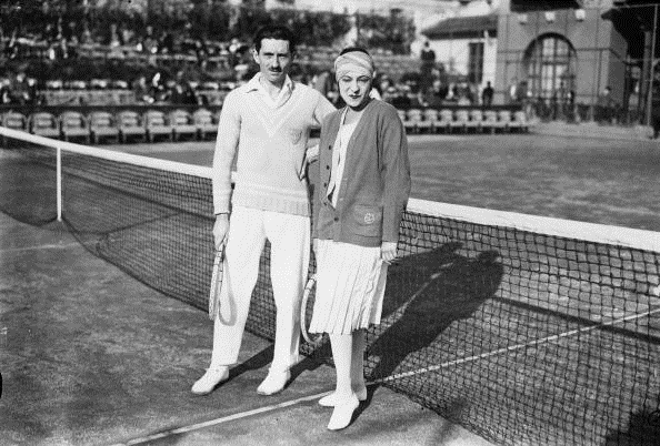 Jacques Brugnon with Suzanne Lenglen during a mixed doubles event (Photo: Brooke/Getty Images)