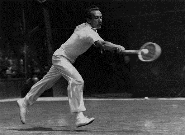 Henri Cochet in action at Wimbledon, where he went on to win ther title (Photo: Central Press/Getty Images)