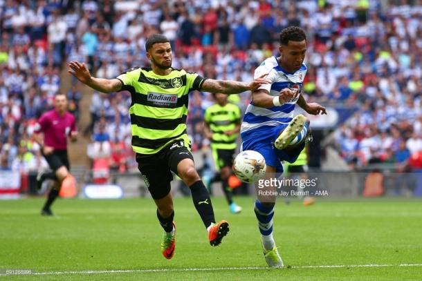 Wells (left) in the play-off final in May. | Photo: Getty/Robbie Jay Barratt - AMA.
