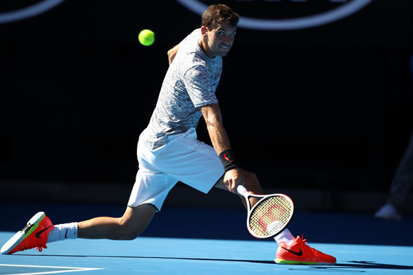 Dimitrov reaches for a backhand (Photo by Clive Brunskill/Getty Images)