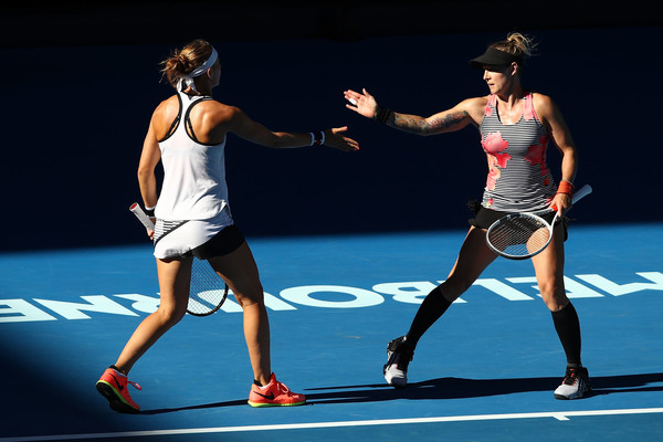 Safarova and Mattek-Sands celebrating winning a point | Photo: Clive Brunskill/Getty Images AsiaPac