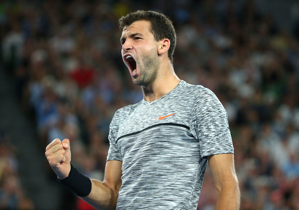 Dimitrov celebrates taking the fourth set (Photo by Michael Dodge/Getty Images)