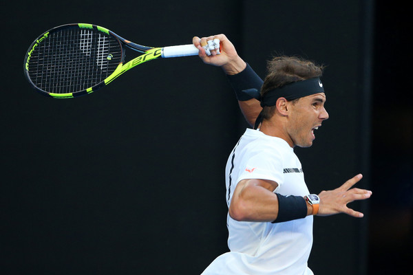 Nadal fires a forehand (Photo by Michael Dodge/Getty Images)