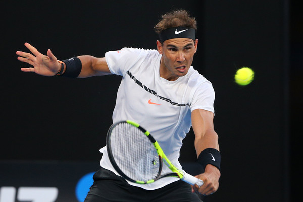 Nadal slices a backhand (Photo by Michael Dodge/Getty Images)