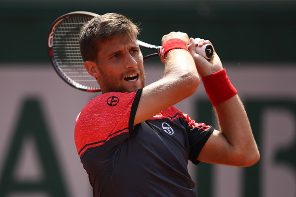 Klizan strikes a backhand (Photo by Julian Finney/Getty Images)