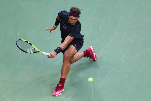Nadal slides to retrieve a backhand (Photo: Al Bello/Getty Images North America)