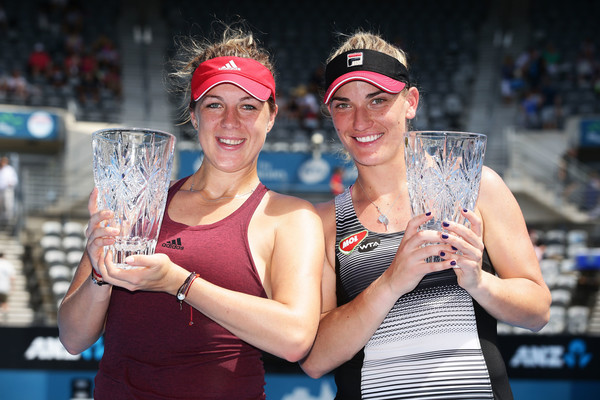 Babos and Pavlyuchenkova pose with their trophies in Sydney | Photo: Matt King/Getty Images AsiaPac