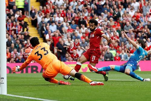 Reds são mais efetivos que Gunners e saem em vantagem no intervalo (Foto: Divulgação/Premier League)