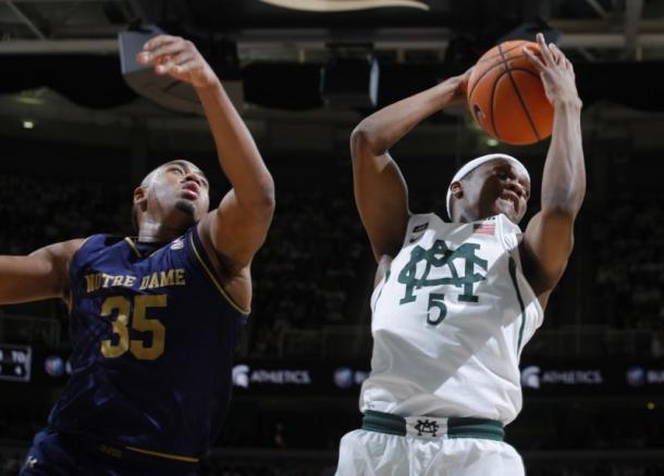 Michigan State's Cassius Winston grabs a rebound in front of Notre Dame's Bonzie Colson/Photo: Al Goldis/Associated Press