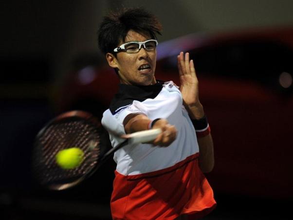 Hyeon Chung strikes the ball as he upsets Borna Coric (Photo: AFP)