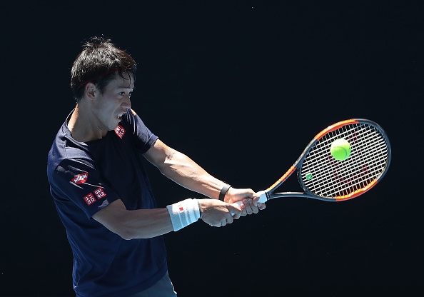 Kei Nishikroi working on his backhand (Photo: Scott Barbour/Getty Images)