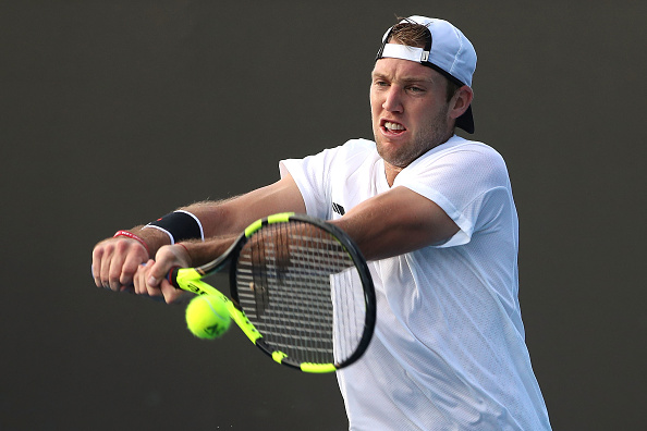 Jack Sock plays a backhand to Pierre-Hugues Herbert (Photo: Scott Barbour/Getty Images)