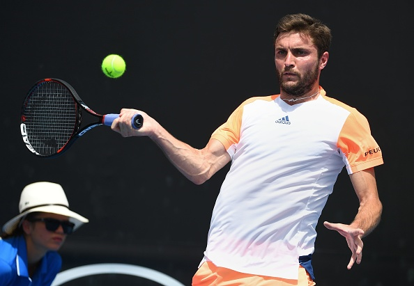 Gilles Simon hitting a forehand return (Photo: Safeed Khan/Getty Images)