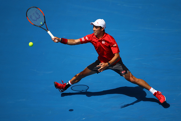 Kei Nishikori reaching for a shot (Photo: Clive Brunskill/Getty Images)