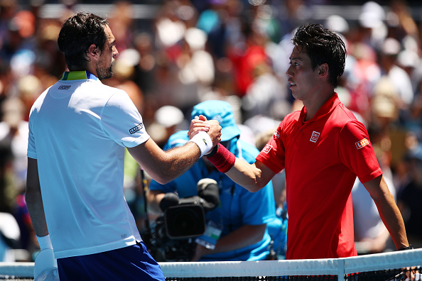 Kei Nishikori and Jeremy Chardy shake hands after the match (Photo: Clive Brunskill/Getty Images)