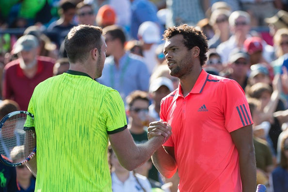 Jo-Wilfried Tsonga shakes hands with Jack Sock in their last meeting at the US Open in 2016