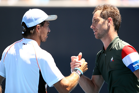 Richard Gasquet consolidates Carlos Berlocq after their second round match (Photo: Cameron Spencer/Getty Images)