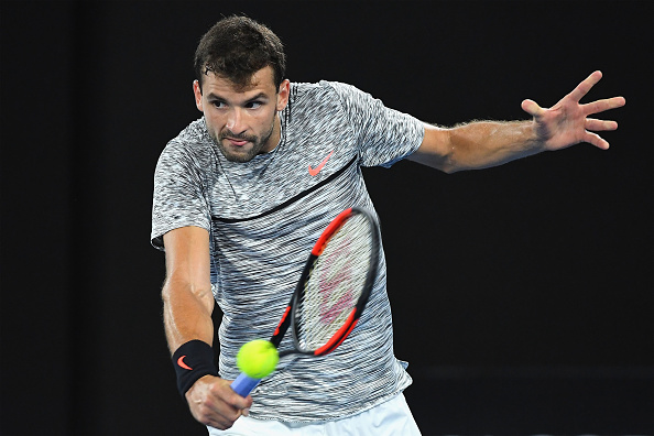 Grigor Dimitrov plays a backhand slice (Photo: Quinn Rooney/Getty Images)