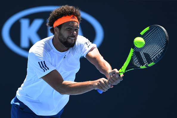 Jo-Wilfried Tsonga playing a bachand shot against Dusan Lajovic (Photo: Quinn Rooney/Getty Images)