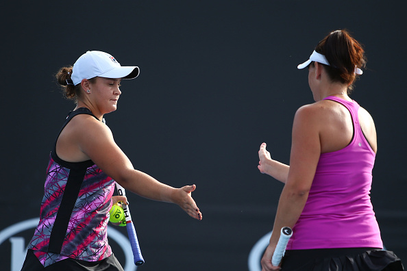 AShleigh Barty and Casey Dellacqua high five after winning a service game (Photo: Jack Thomas/Getty Images)