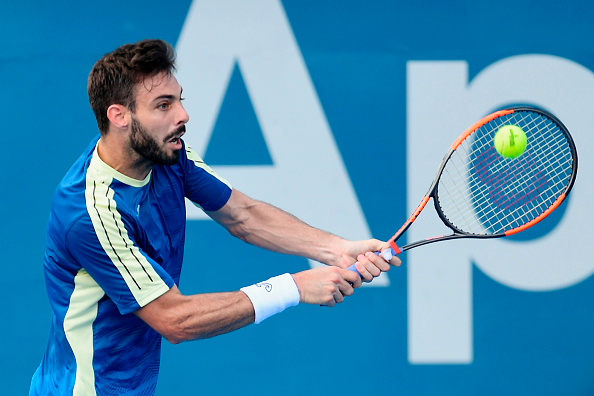 Marcel Granollers hits a backhand (Photo: Brett Hemmings/Getty Images)