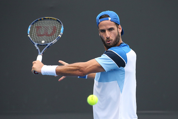 Feliciano Lopez hits a slice (Photo: Pat Scala/Getty Images)