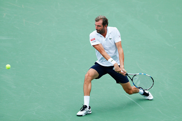 Julien Benneteau gearing up to hit a shot (Photo: Joe Robbins/Getty Images)
