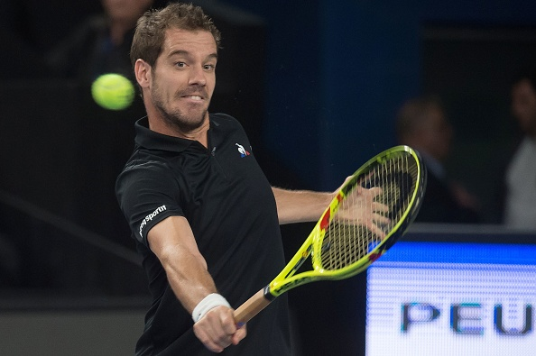 Richard Gasquet hits a return to Gael Monfils (Photo: Bertrand Langlois/Getty Images)
