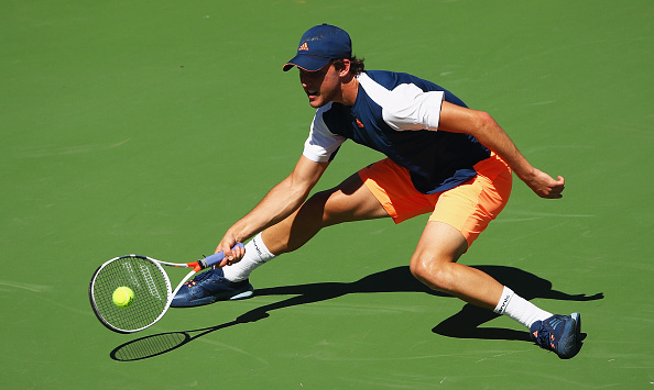 Dominic Thiem reaches for a shot (Photo: Clive Brunskill/Getty Images)