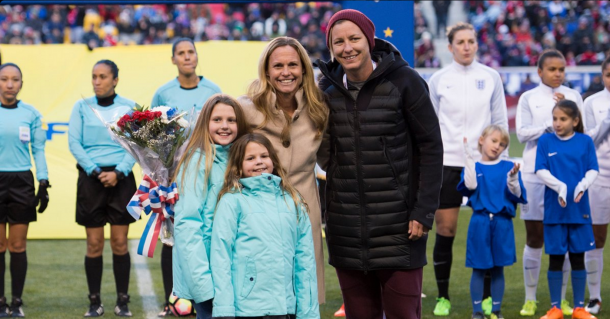Christie Rampone at her SheBelieves Cup tribute along with her daughters and Abby Wambach. (Source: Sky Blue's twitter @SkyBlueFC)