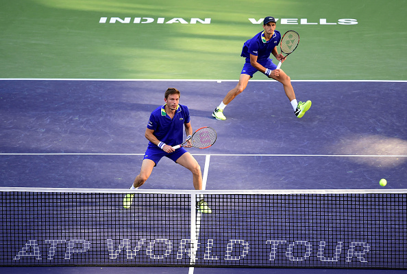 Pierre-Hugues Herbert and Nicolas Mahut in action during their three set loss to Novak Djokovic and Viktor Troicki (Photo: Harry How/Getty Images)