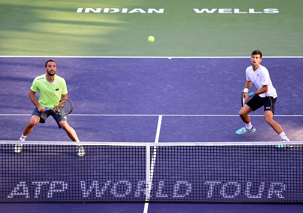 Novak Djokovic and Viktor Troicki keepo their eyes peeled on a ball over the net (Photo: Harry How/Getty Images)