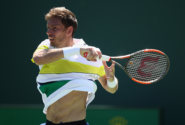 Nicolas Mahut plays a forehand shot (Photo: Julian Finney/Getty Images)
