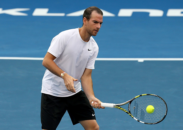 Adrian Mannarino plays a volley (Photo: Dave Rowland/Getty Images)
