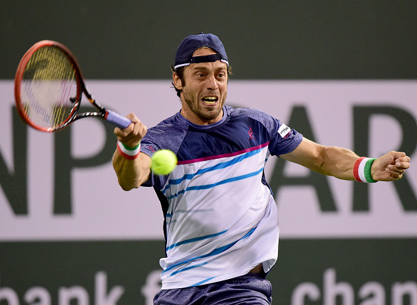 Paolo Lorenzi hits a volley during the BNP Paribas Open last week (Photo: Harry How/Getty Images)
